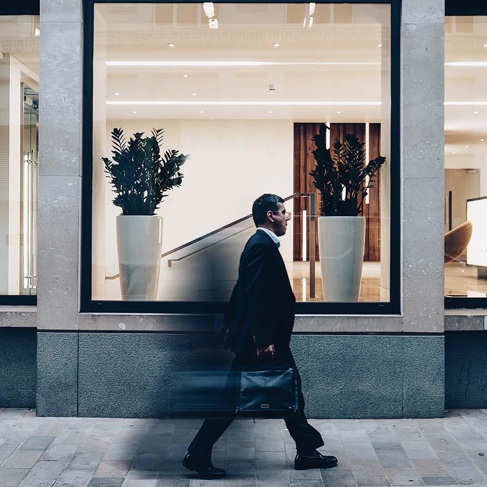 business man walking forward, determined.